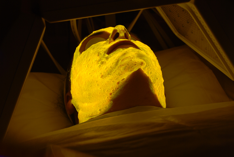 The patient is placed under the multi-wavelength LED lamp at this stage the gel glows a bright yellow.