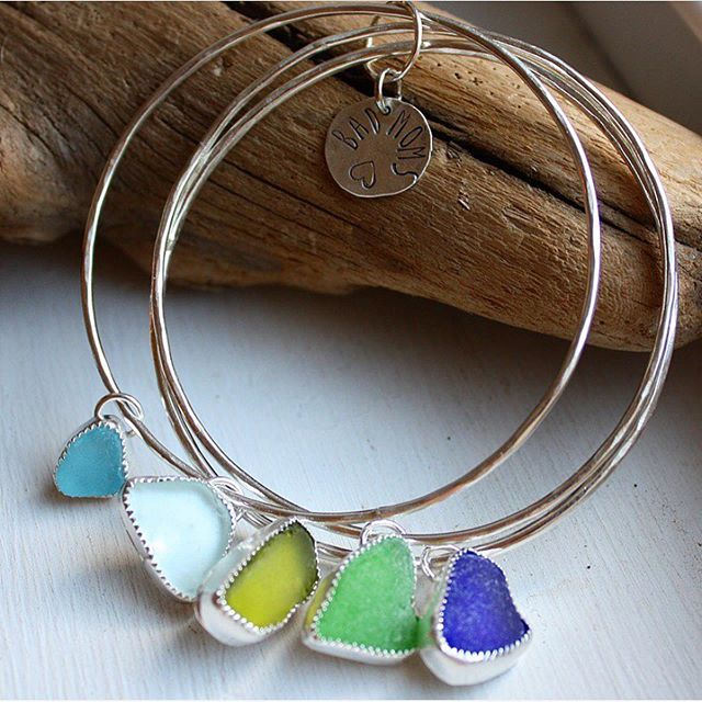 Hey everyone! 👋🏼 Reminiscing on this sweet little #throwback to a summer or so ago when I made these custom seaglass stacks for a group of #badmoms 👯‍♀️👯‍♀️ We are finally in the swing of summer over here in Maine— even though it took FOREVER this year for the nice weather to arrive! ☀️ I've been missing all of you so much as I grow this babe, although I also do appreciate this season of my life very much and am cherishing every single day. 👶🏻🌈💙 Swipe to see photos of my baby shower from a couple of weeks ago! All of you smiths and artists that participated in my @whimsiebaby auction— can you even believe we are at this point?! 🥰 I still can't express my gratitude enough for this community, and I cannot, cannot, CANNOT wait to be back at the bench in November! 🤗💙🌈🥰 Thank you all so much for hanging tight while we grow our first Baby Holland! #teambabyholland . . . . #silversmith #ladysmith #love #summer #newengland #capecod #maine #coast #handcrafted