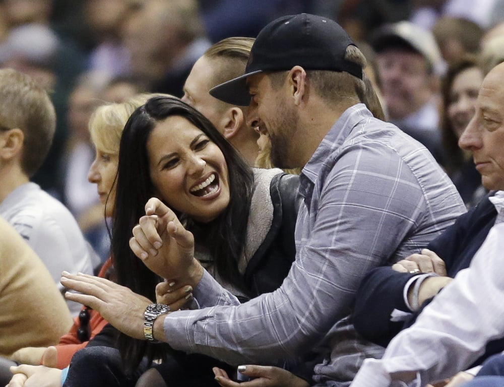 """*""""How much of a chance does the world have at making more attractive and excellent babies than us?"""" -- Olivia Munn  """"Oh, I'd say about this much."""" -- Aaron Rodgers  """"Hahaha"""" -- Both  """"I have to be grumpy and think about business stuff while at this basketball game. Harumph."""" -- Businessman to Aaron's left  *Probably how it all went down"""