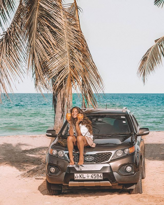 I've been roadtripping Sri Lanka with @hesguru in this sporty guy from @amerirentacar for two and a half weeks now! ≋ Driving here has been such an adventure filled with colorful chaotic towns, roadside coconut stops and many a beach stop (we pulled over at basically every pretty beach we passed 😂🤷🏽♀️). ≋ One of the more memorable experiences was our roadtrip down the less developed Eastern Coast of Sri Lanka, stopping for several nights in Kalkudah to chill on the perfect white sand swimming beaches before heading south to the surf haven that is Arugam Bay. This photo was taken in a village between these two places. We even saw a wild elephant and peacocks on that drive! ≋ While there are many ways to explore Sri Lanka, self-driving with the help of @amerirentacar was the perfect fit for us (ok @hesguru did all the driving lol). We saw so much of this gorgeous country we would not have been able to fit in otherwise, tried food in small villages that were out of the tourist towns and just generally roamed as we pleased.