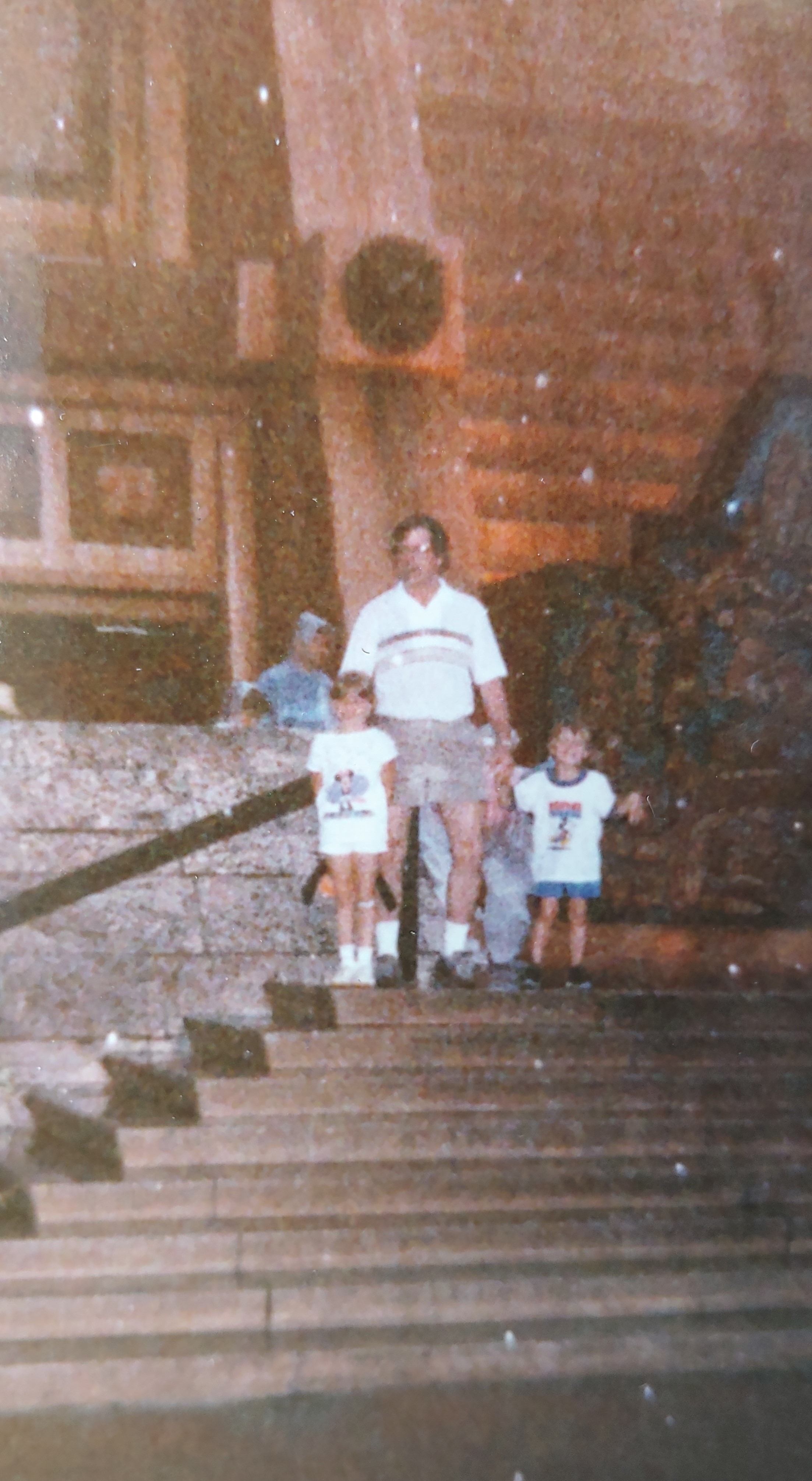 randy and kids at disney in rain.jpg