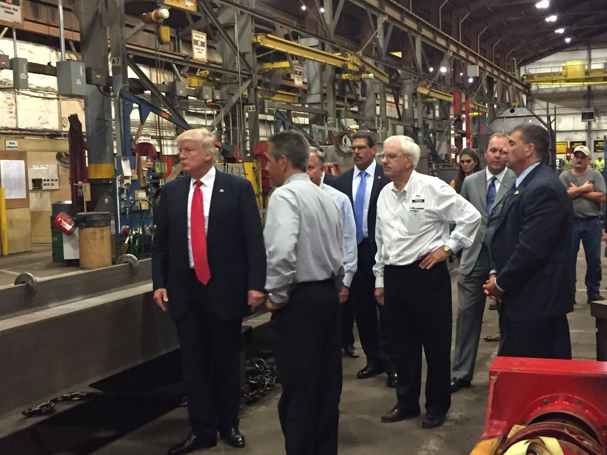 Republican Presidential nominee Donald Trump (left) tours McLanahan Corp. before Altoona rally.
