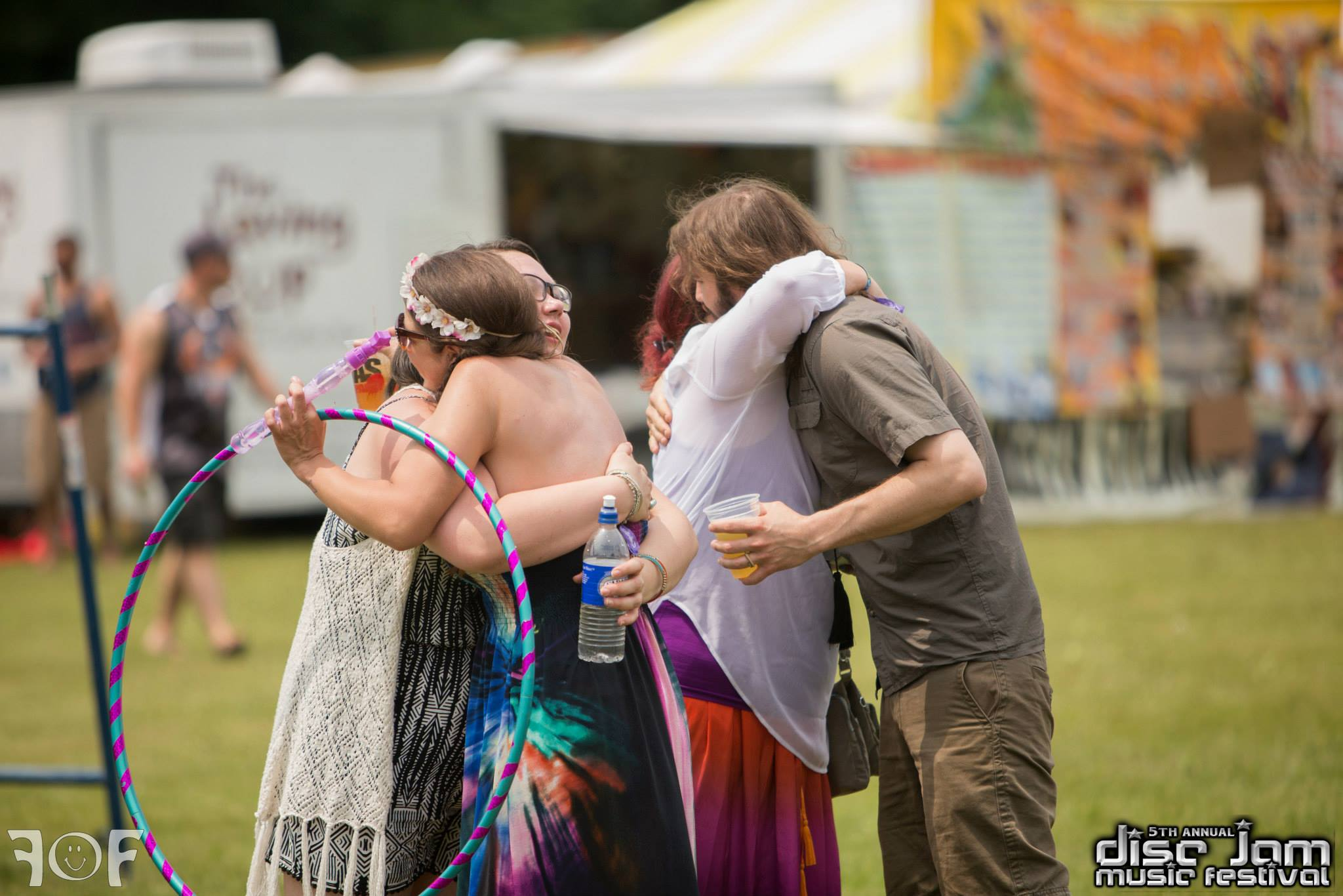 Hugs all around!    Source: Faces of Festivals and Disc Jam