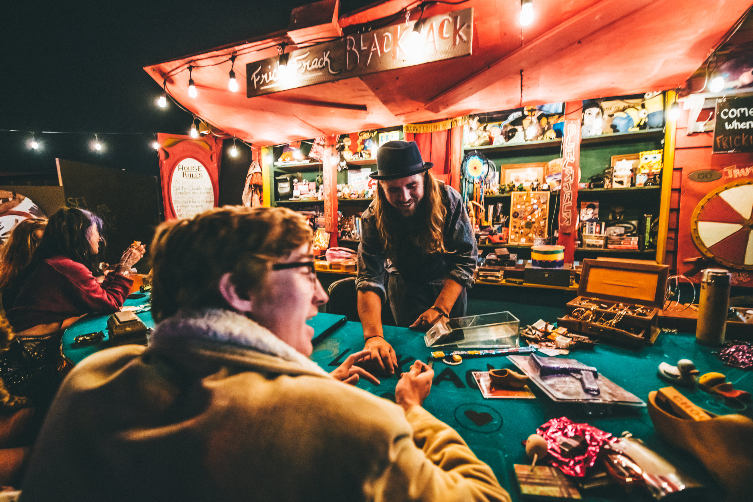 Festival goers play a game of black jack at the Grand Artique   📷: Juliana Bernstein