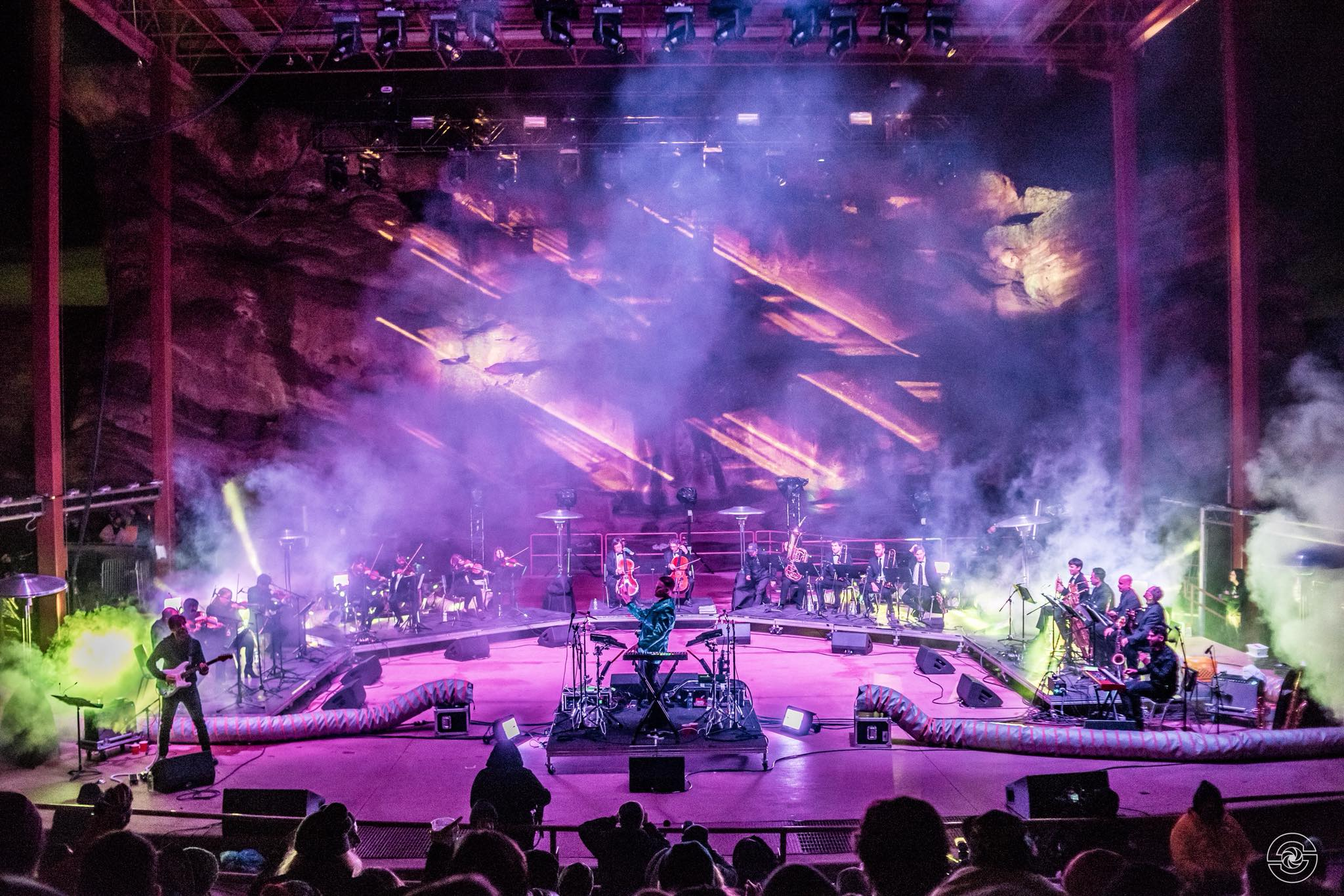 Opiuo peforming with the Syzygy Orchestra at Red Rocks Amphitheater.