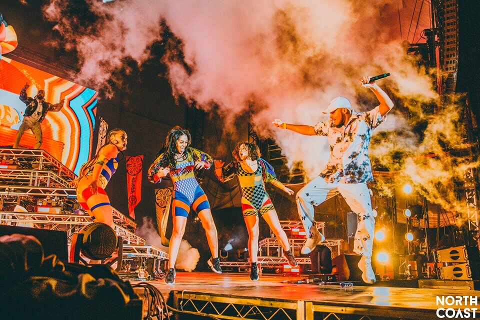 Photo By: McinChey Photography. Major Lazer's dancers bring the energy to the feet of the crowd.