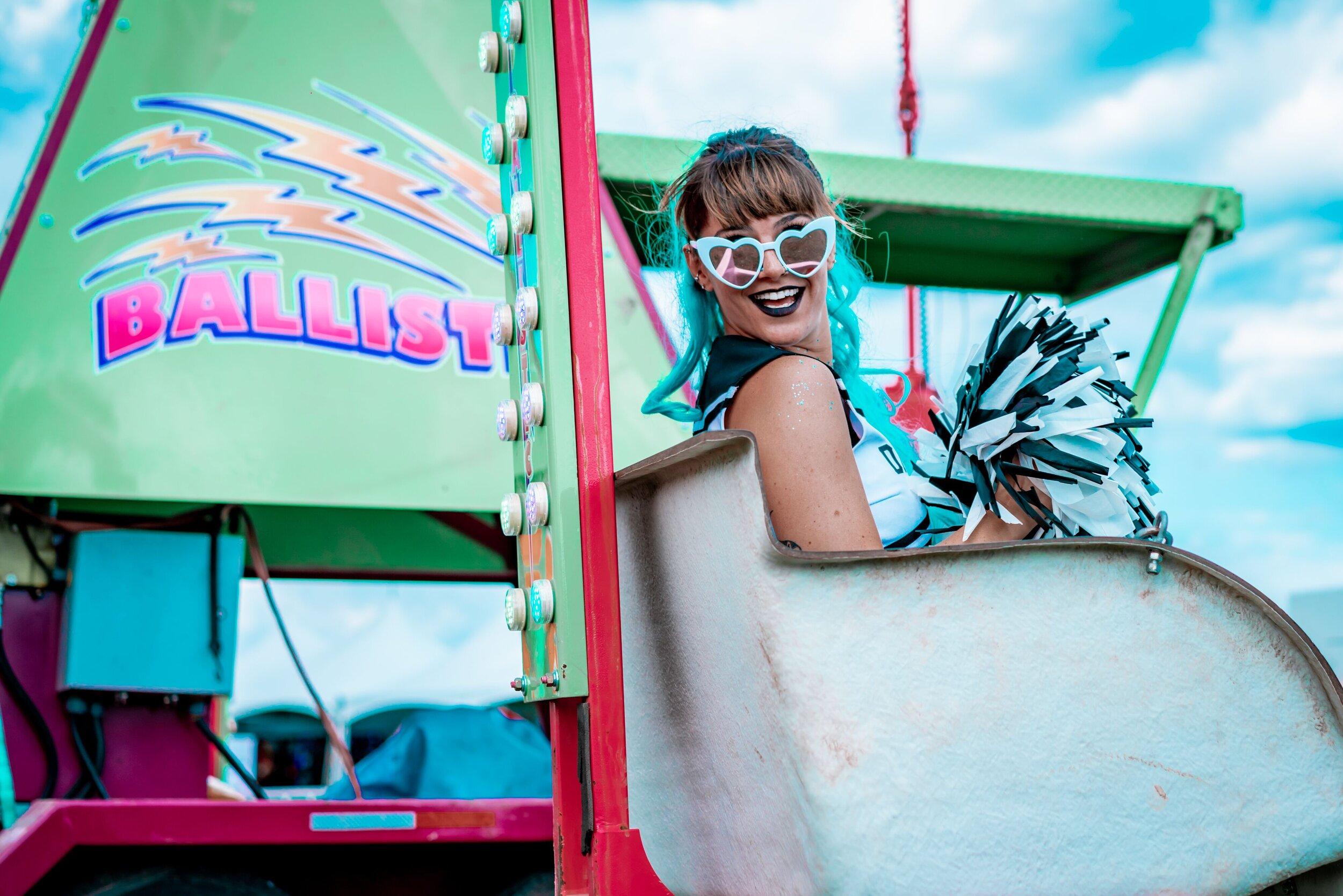 Dirtybird Cheerleaders go for a carnival ride