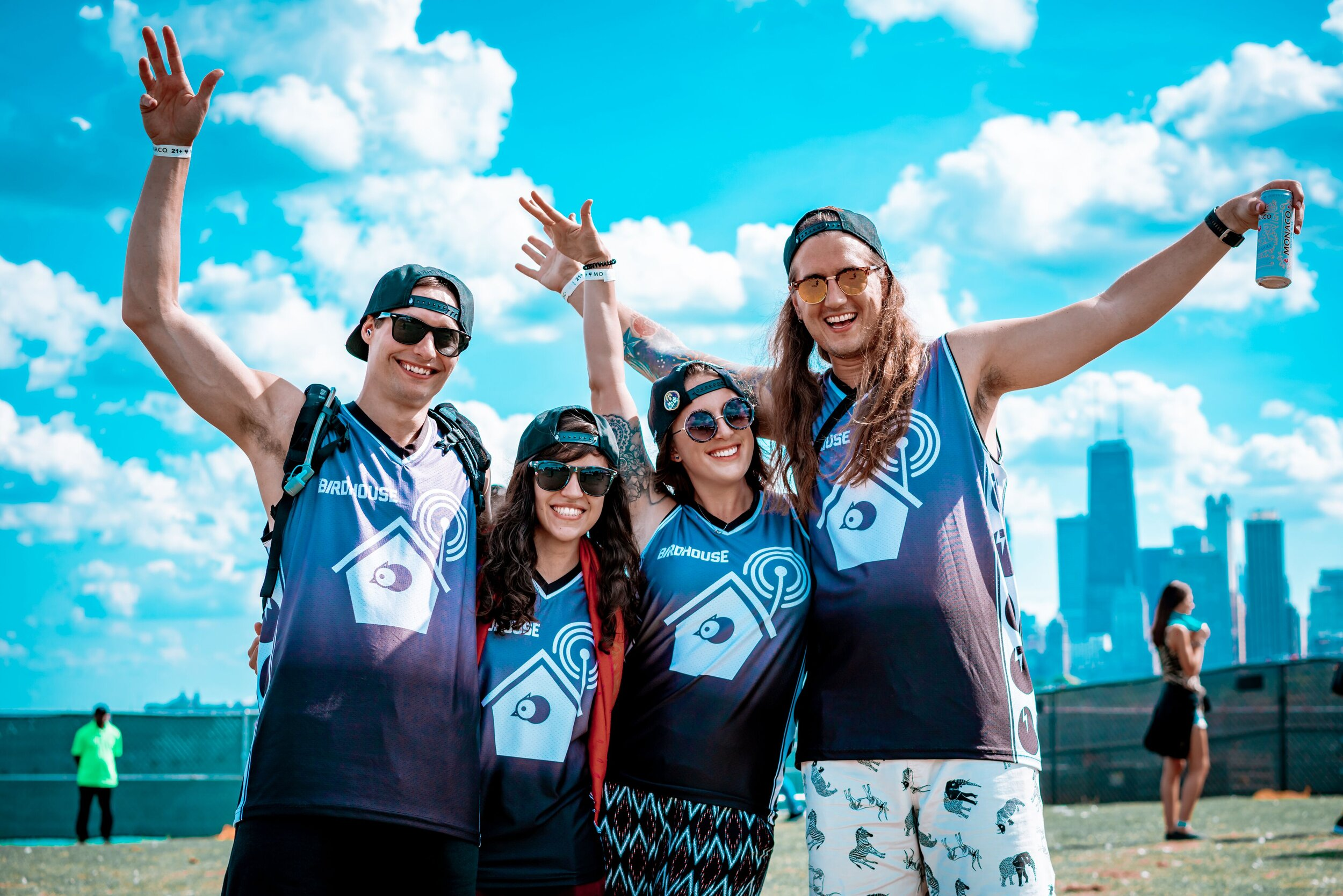 Patrons smile for a picture in their Birdhouse jerseys
