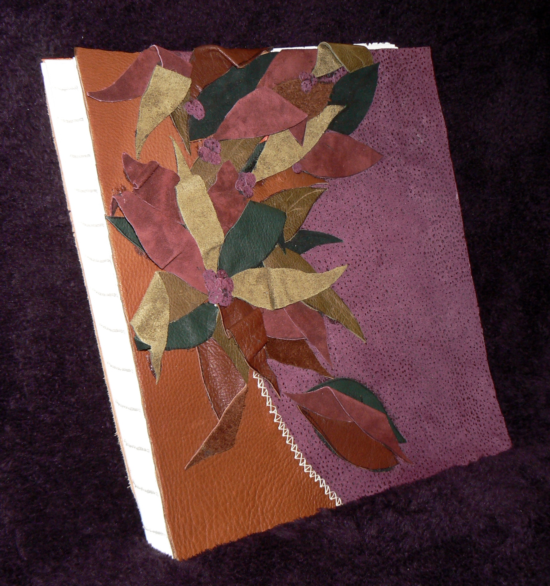 Leather cover and hand-stitched volume, created by Joanne de Biasi, the mastermind behind this project.