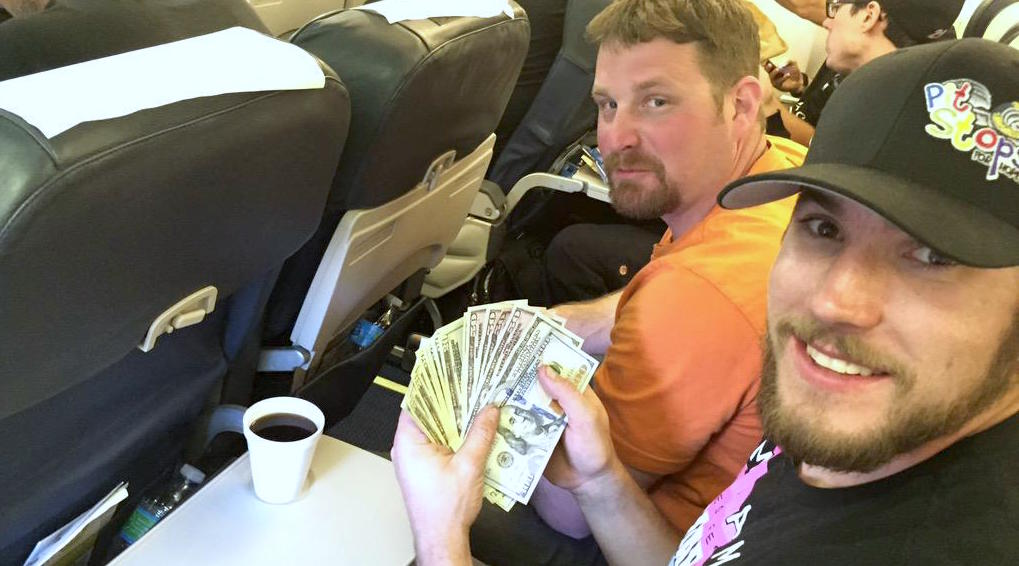 Counting the money to be donated on the plane ride home from Las Vegas Motor Speedway.