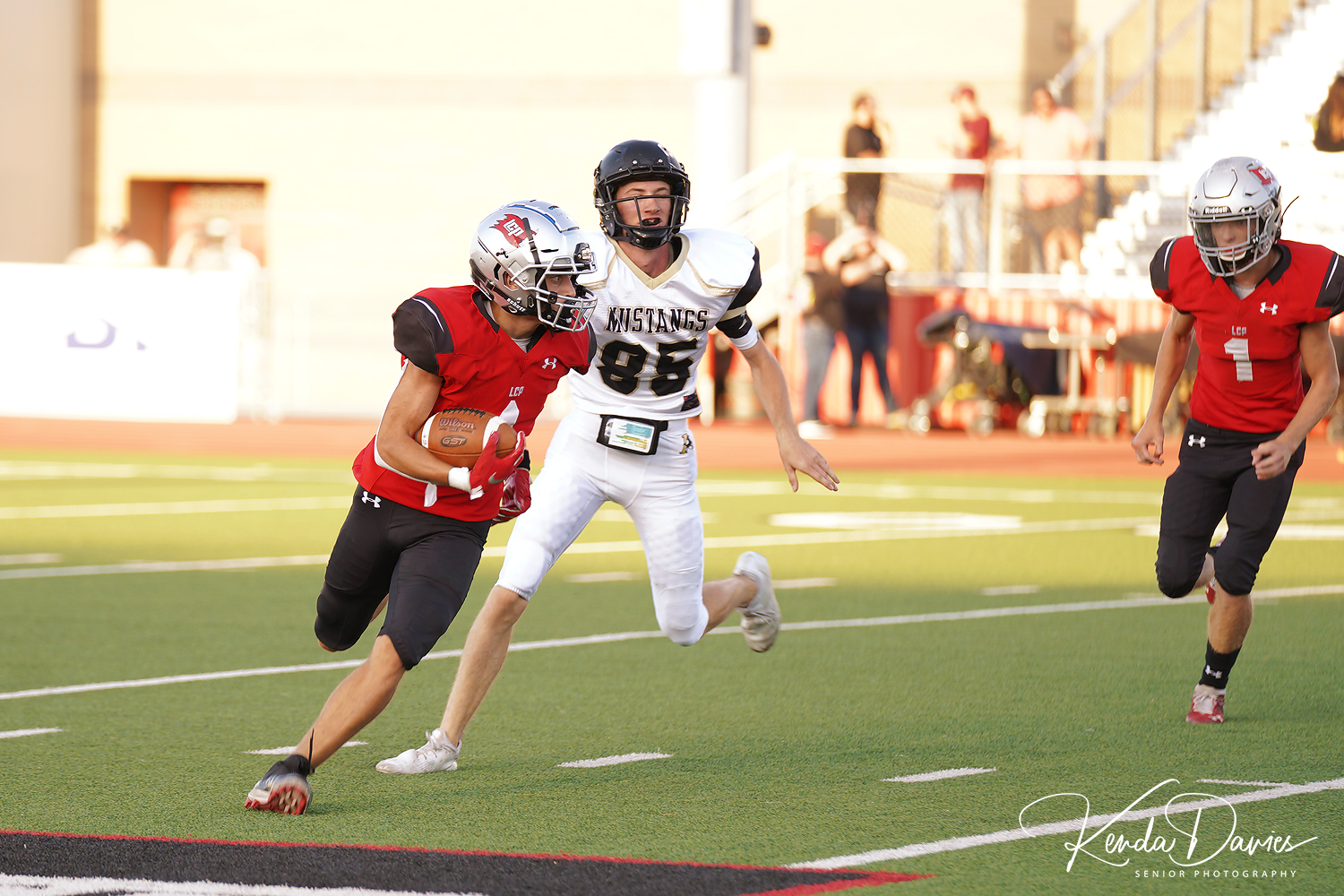 #4 Rylan Wilcox, a junior for the Pirates, picks up some yards leaving a Mustang in the dust.