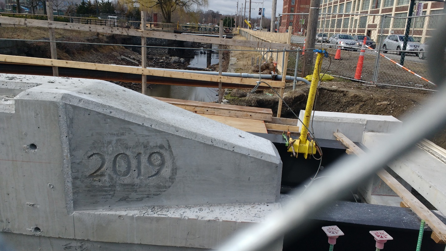The concrete curb of the bridge leading into the Hamilton Canal Innovation District will soon have a steel crash barrier installed on top.