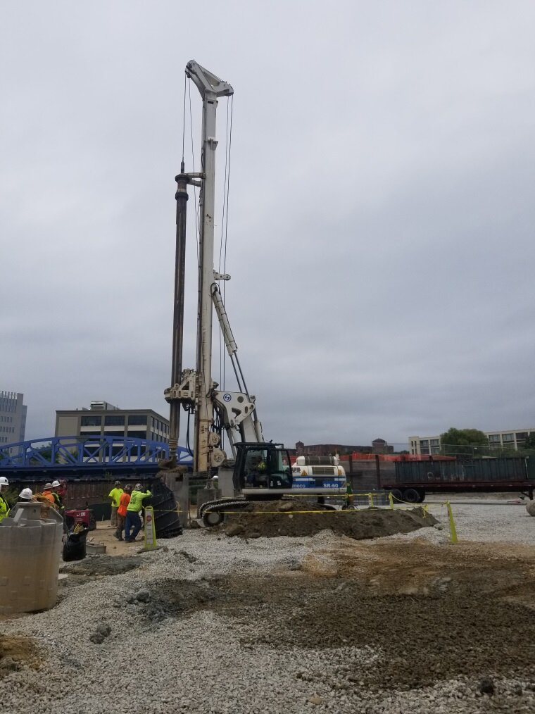 Caisson rig drilling along the southern edge of the future garage.