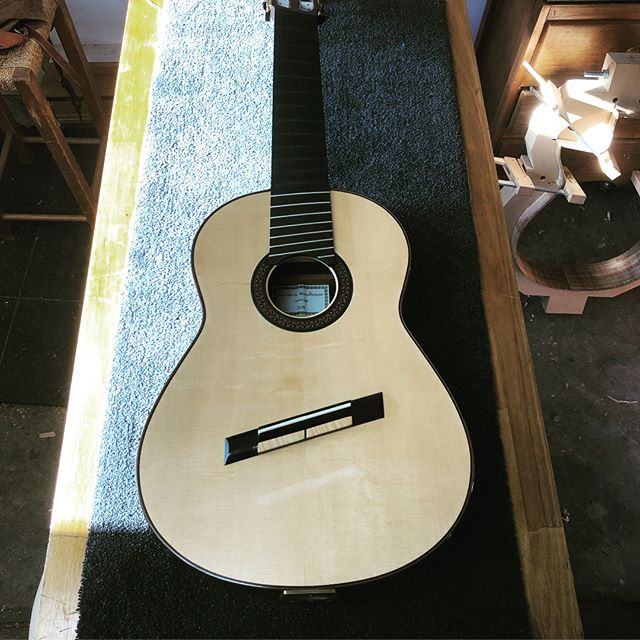 An absolutely beautifully made Martin Woodhouse classical guitar on the bench. #luthier #guitar #classical #melbourne