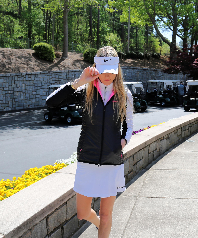 Hat: Nike, Puffer Vest: Nike,Skort:Babylot (tennis), Windbreaker: Colmar