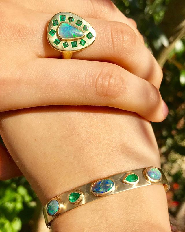Ocean blues and greens in the Summer sun 💎🌿🌞 boulder opal and emerald ring with matching cuff - - - - - - - #Adelphe #adelphejewellery #adelphelondon #phillipahastingsjewellery #boulderopal #emeraldcuff #opalring #opalbangle #gold #summerjewellery #ring #bangle #opals #edenhastings