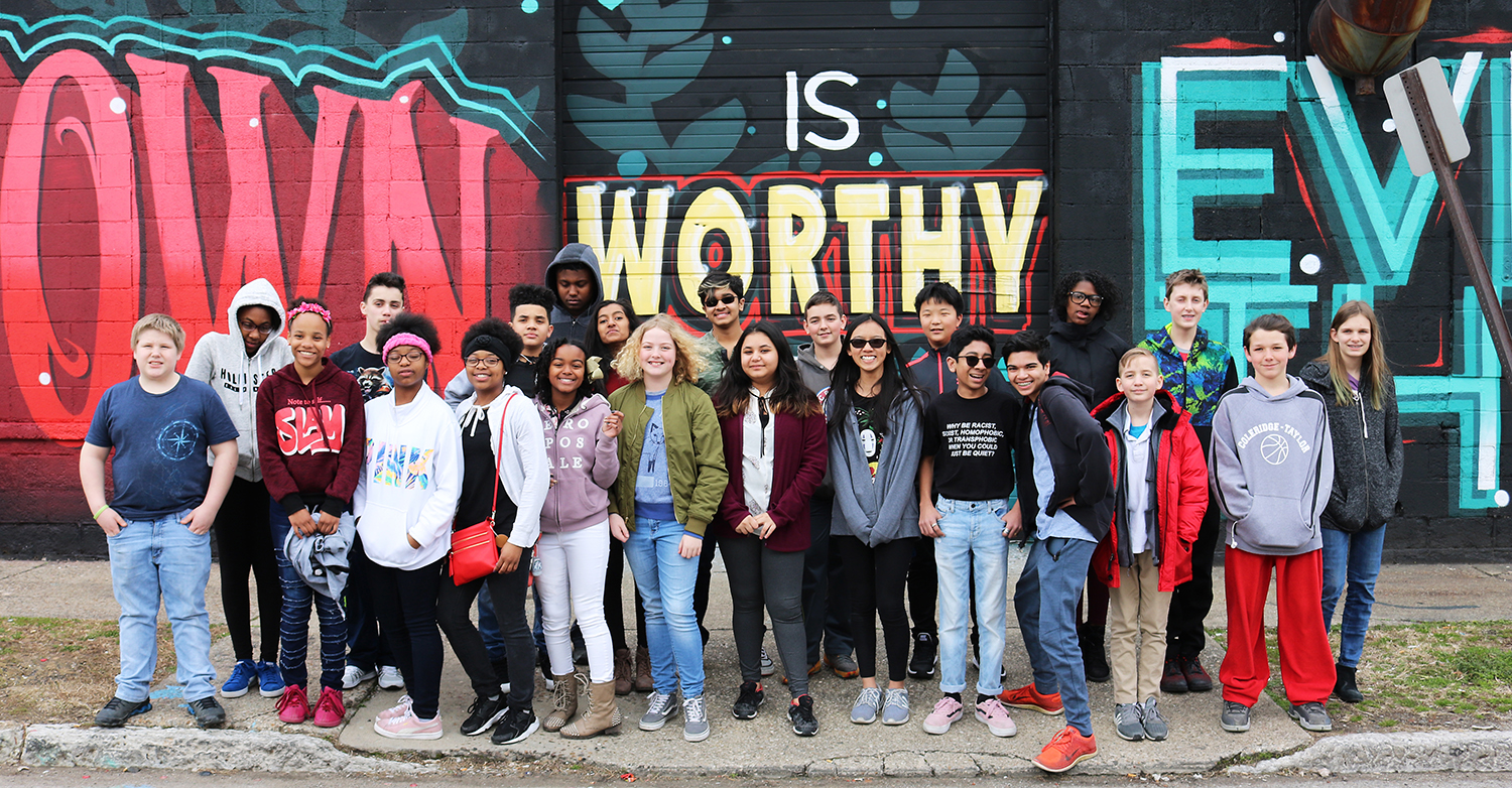 "Justice League participants in from of the ""Smoketown is worthy of everything"" mural. Photo by Josh Miller"