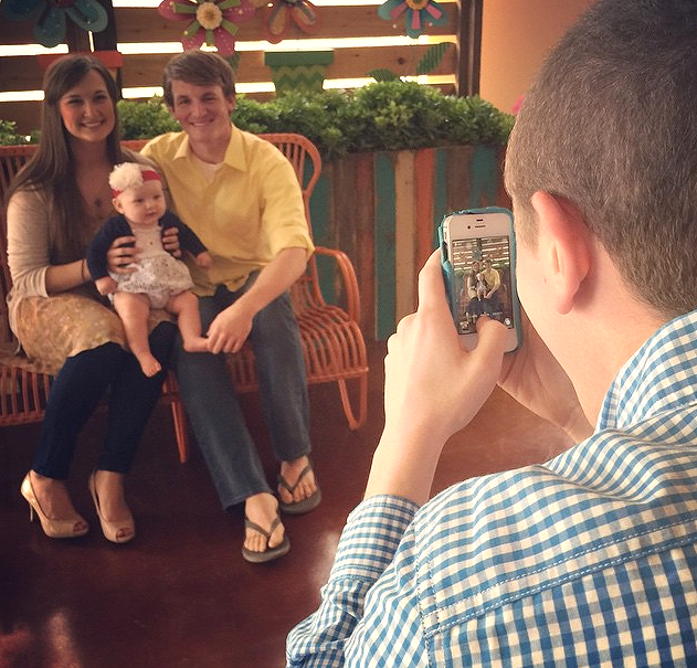 Family with one baby getting a picture taken at Hulen Street Church in Fort Worth, TX.