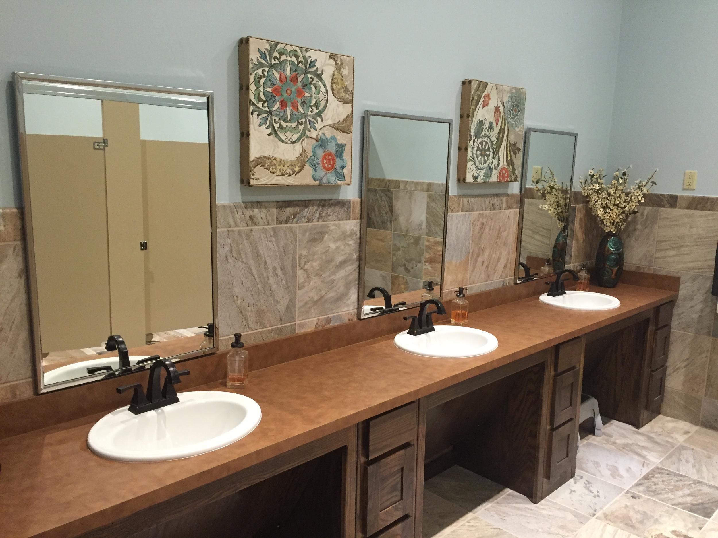 The refinished women's bathroom near the new vestibule | Hulen Street Church