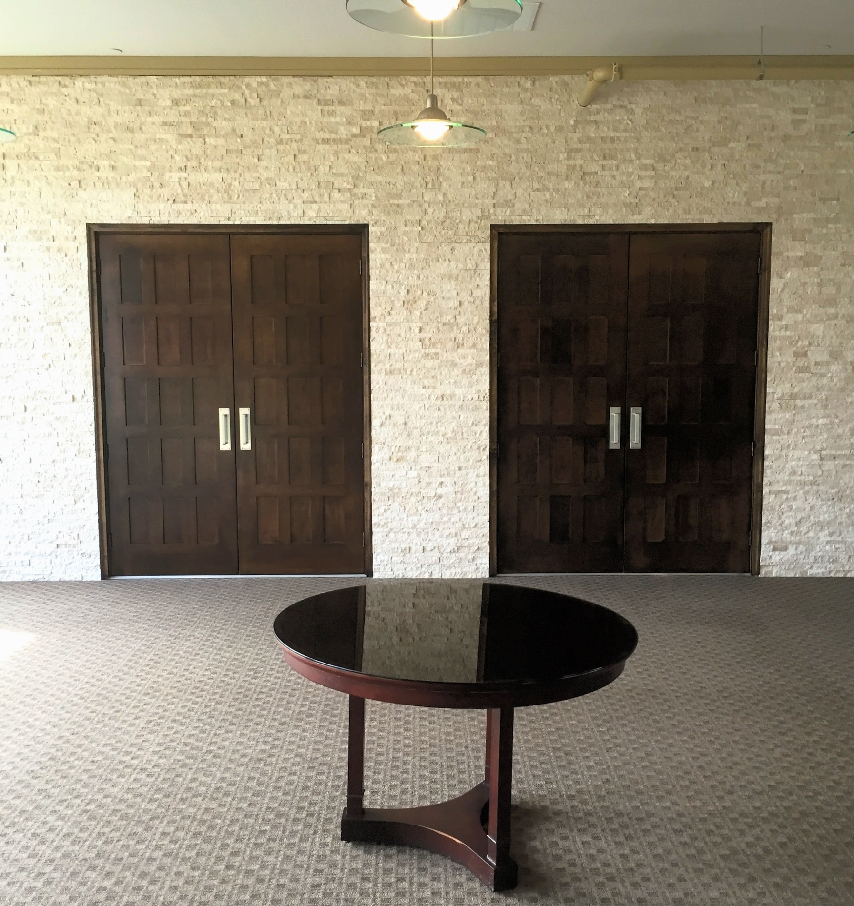 Solid wood doors make up the front of the new vestibule which leads into the Worship Center | Hulen Street Church in Fort Worth, TX