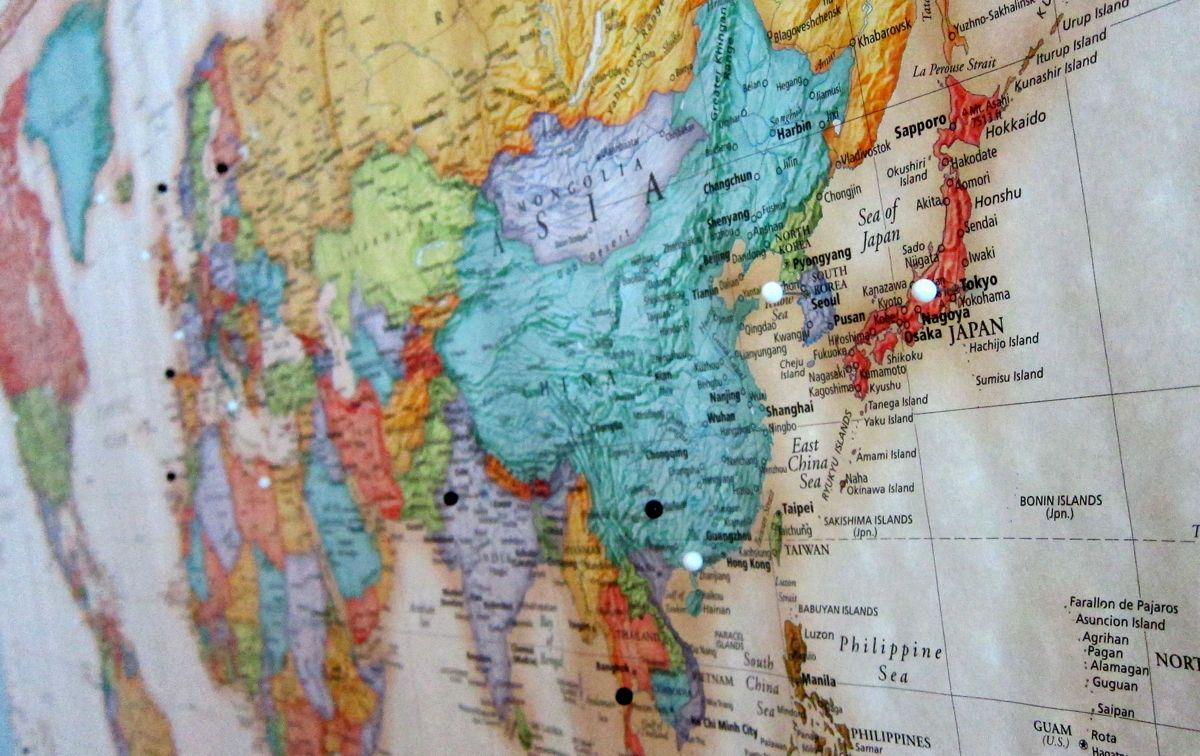 Middle East, Africa, Asia, China on a map with pins