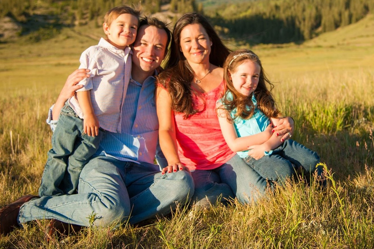 Candice Oster, her husband Daniel, and their two children.