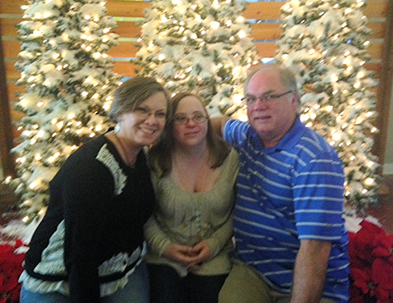 Gary Blalock, on the right, and his wife Lisa, left, and their daughter Michelle in the middle