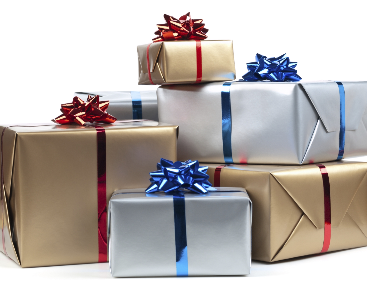Presents stacked in a pile: brown with red ribbon and silver with blue ribbon