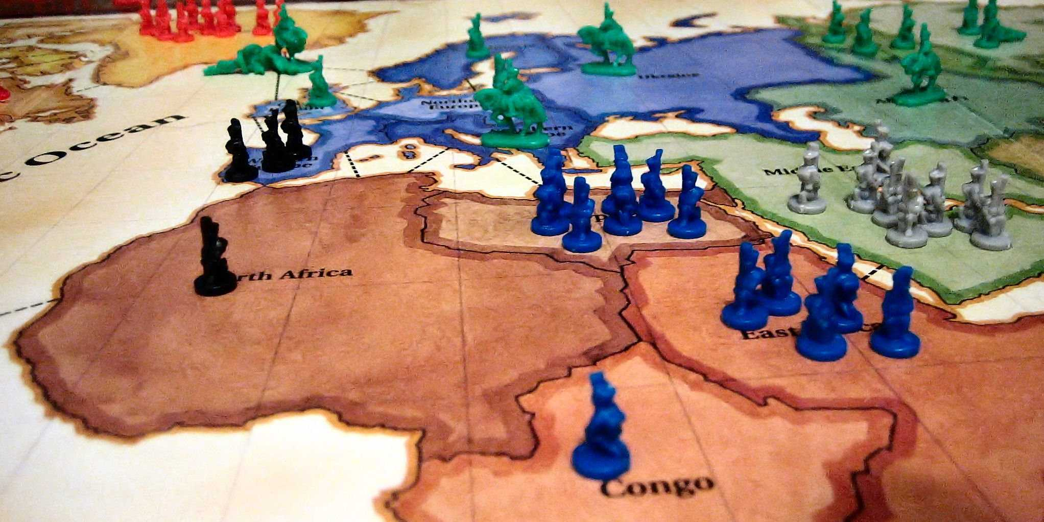 Risk board game with pieces showing Europe, Africa, and Asia
