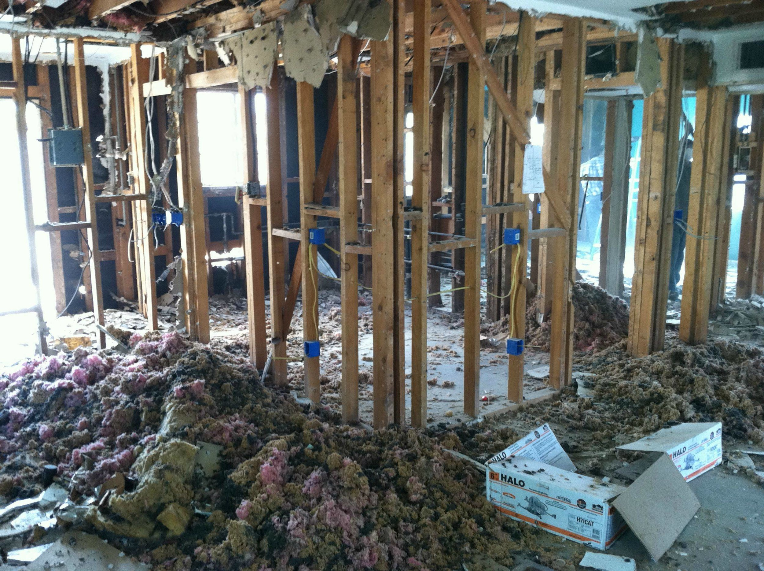 remodeling a house and tearing it down to the studs and foundation.