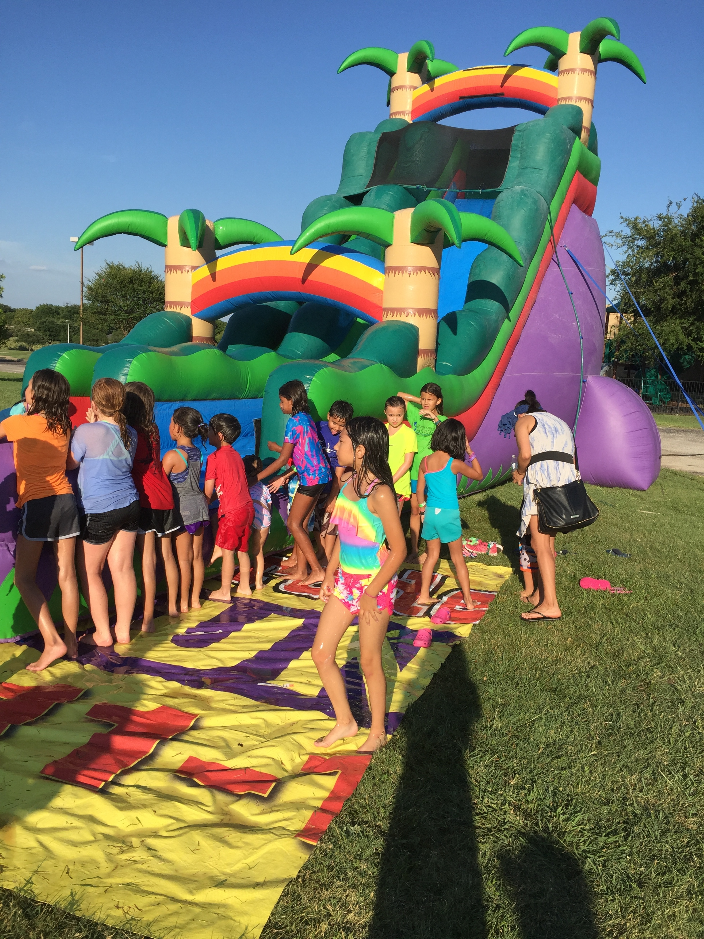 a huge waterslide for kids at the Splash N Dash event at Hulen Street Church in Fort Worth, TX.