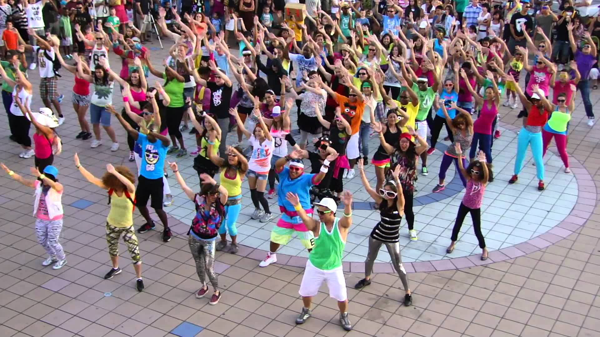 People dancing in a public scene as a flash mob or flashmob