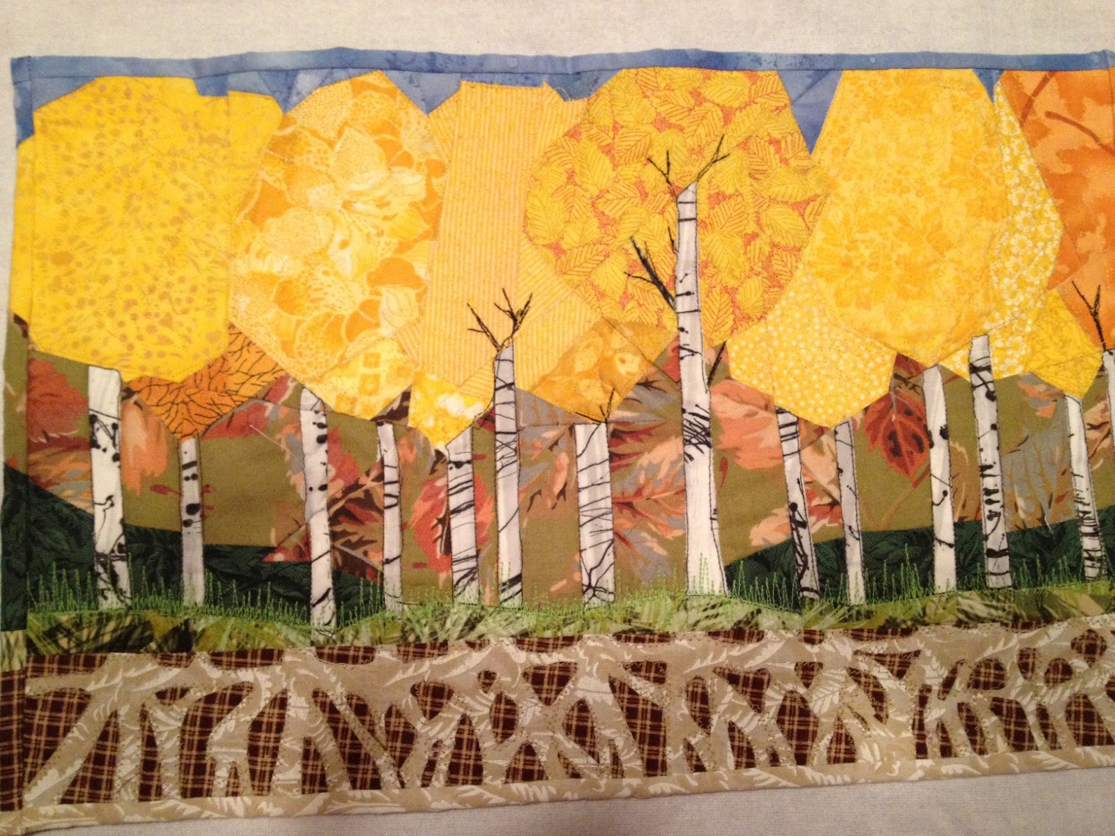 a collage of a shared root system of yellow aspen trees