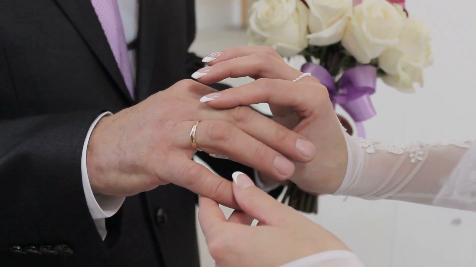 wedding rings exchanged between a bride and a groom, close up