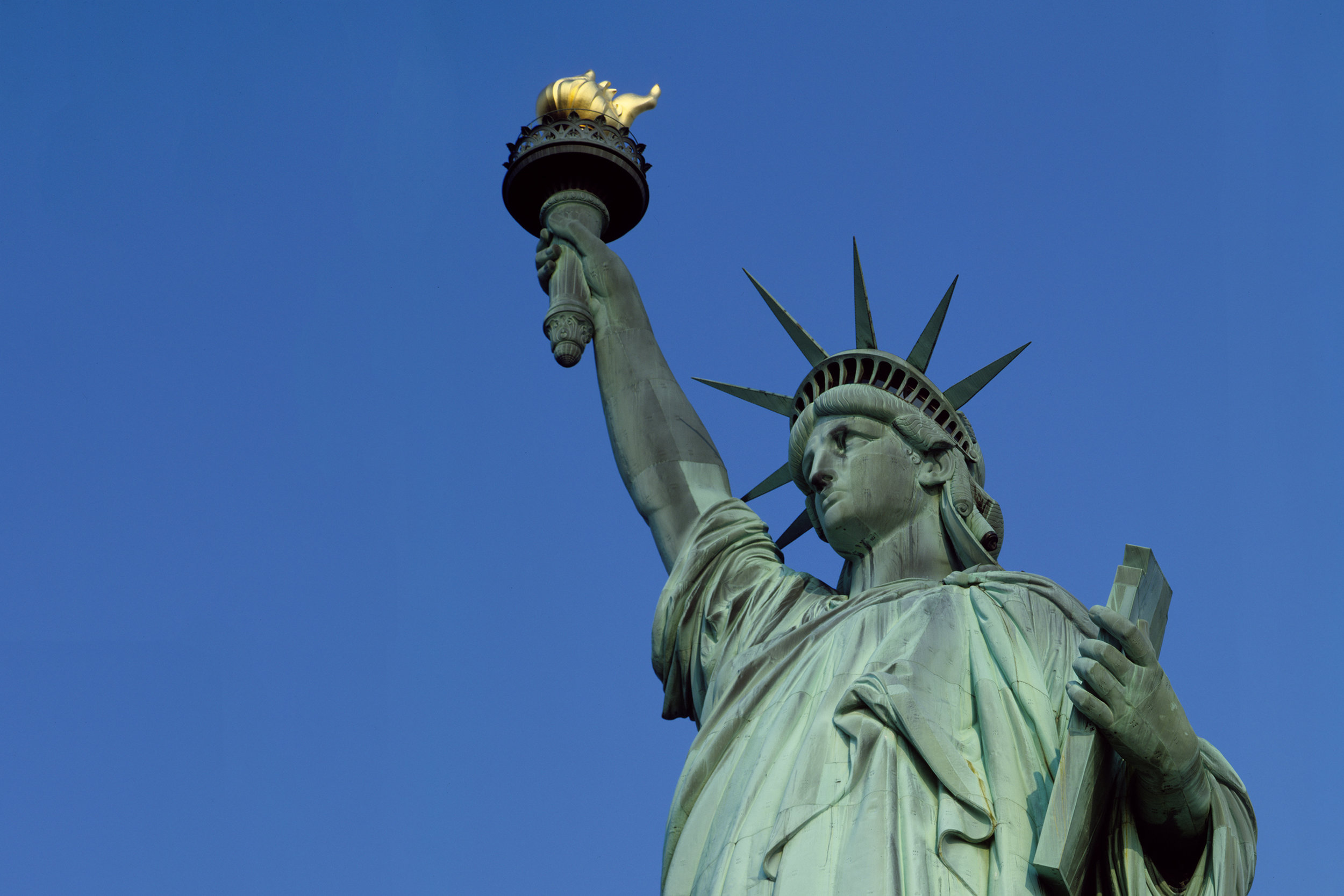 upshot of the Statue of Liberty, signifying freedom and equality for all.