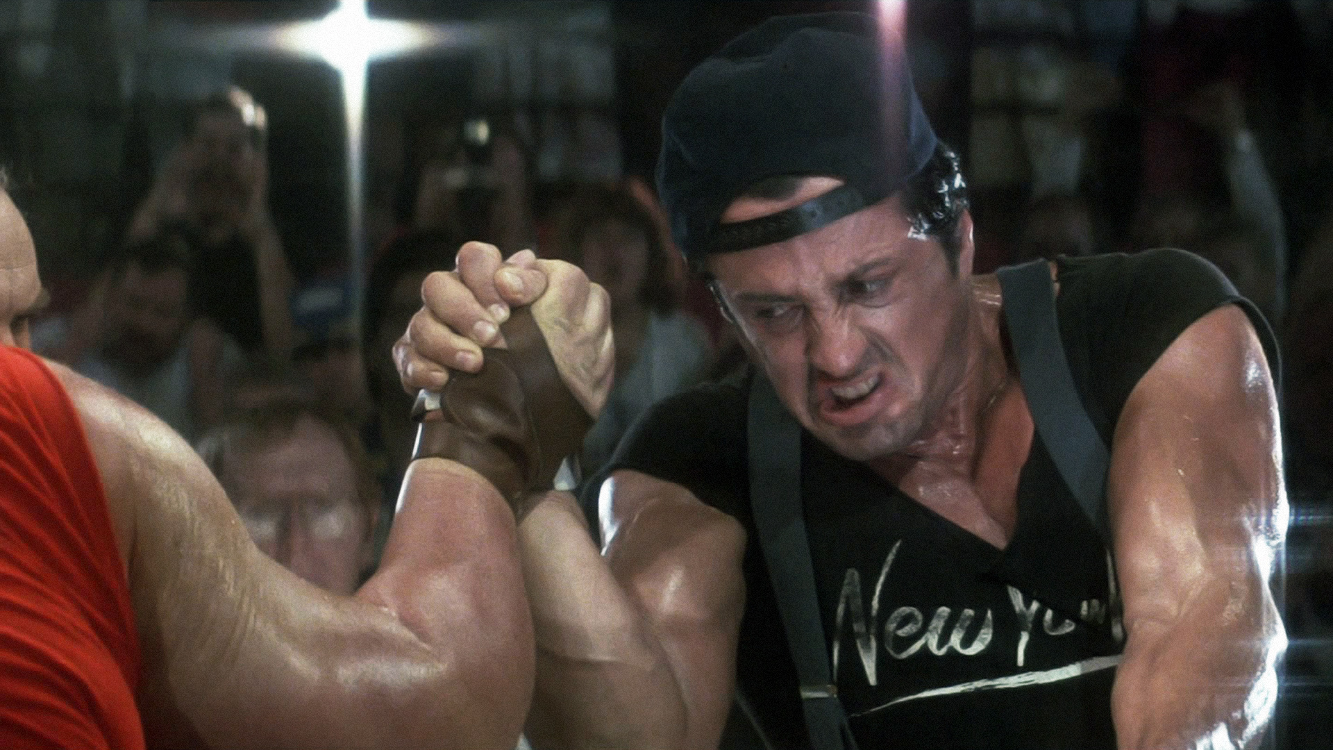 Sylvester Stallone in Over the Top at a climactic arm wrestling scene in front of a big crowd for the championship