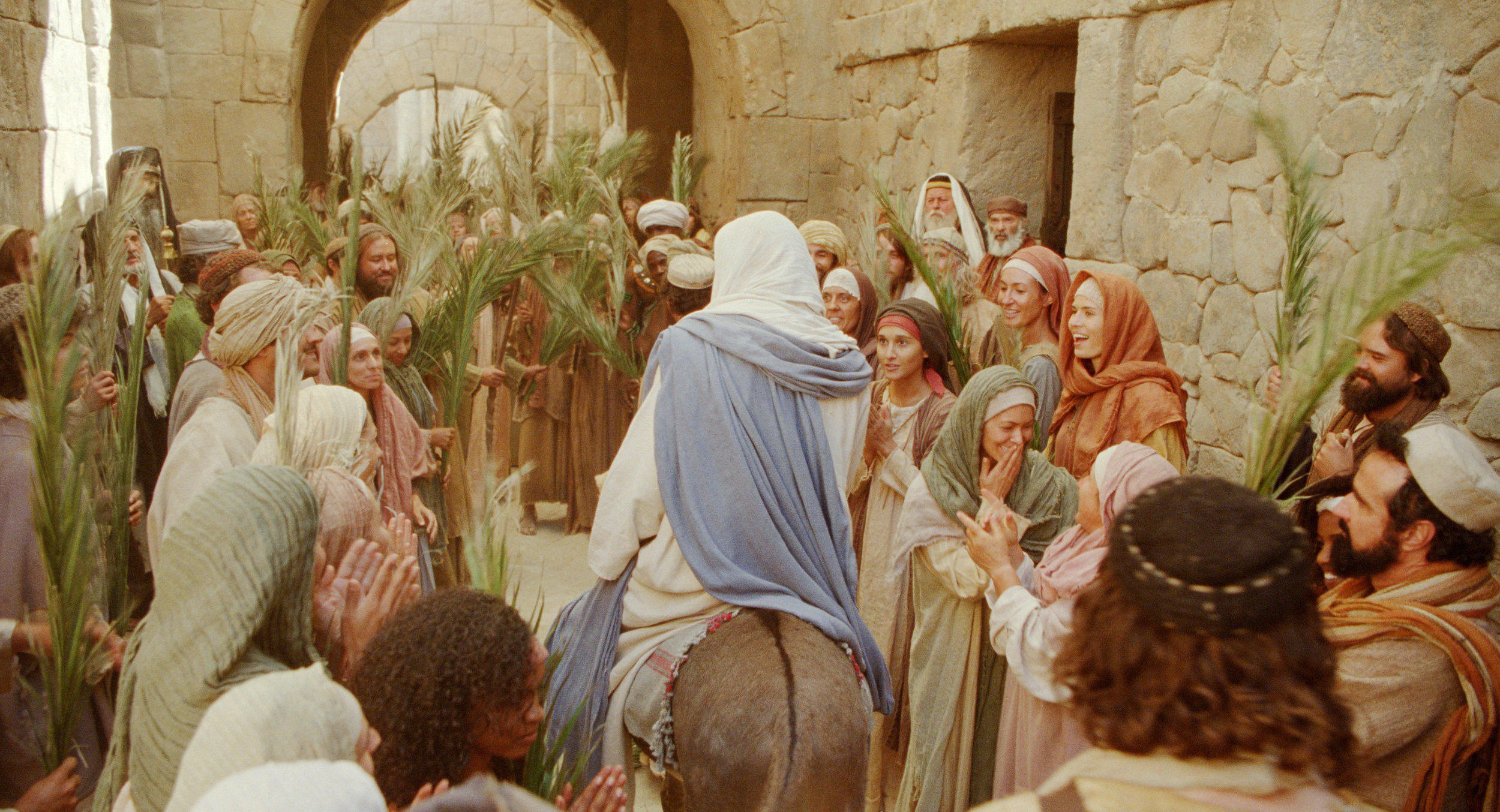 Triumphal Entry movie still Jesus on a donkey among the crowds