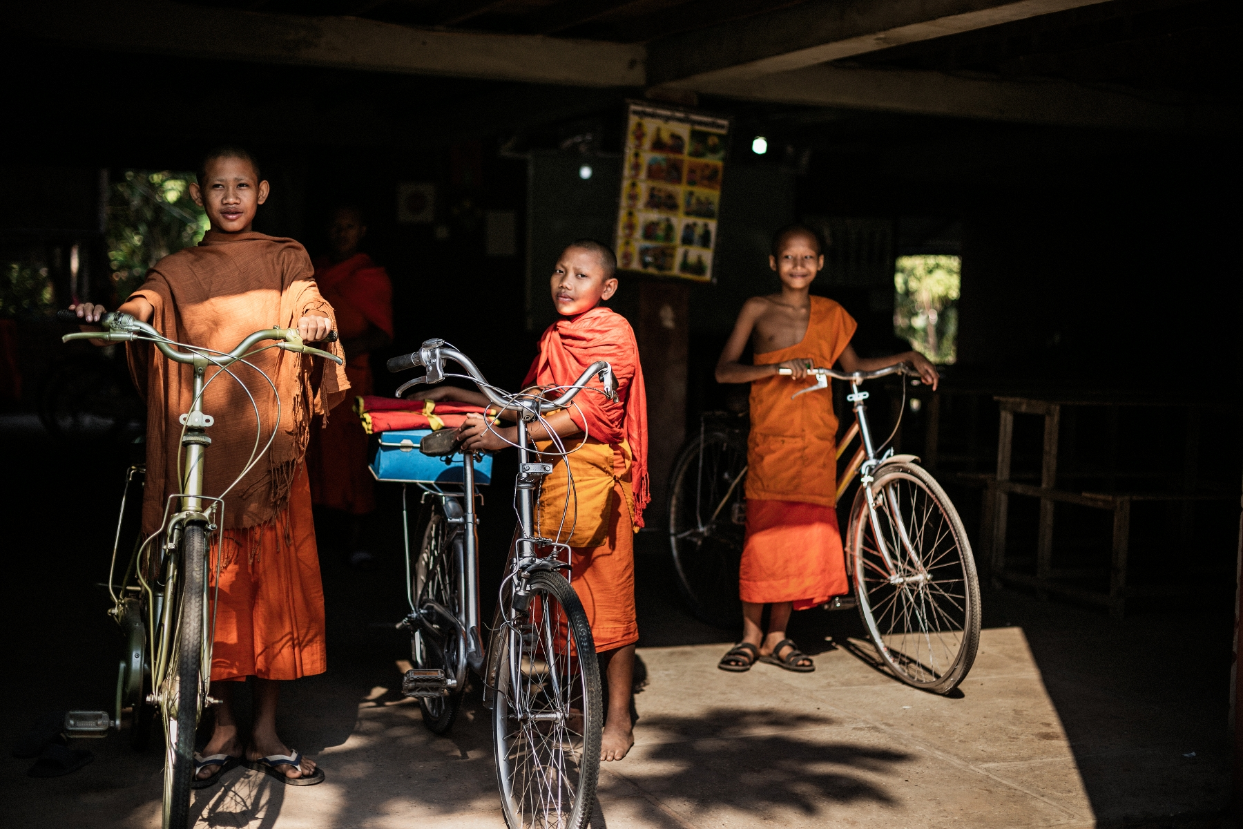 Children monks getting ready for at bicycle ride