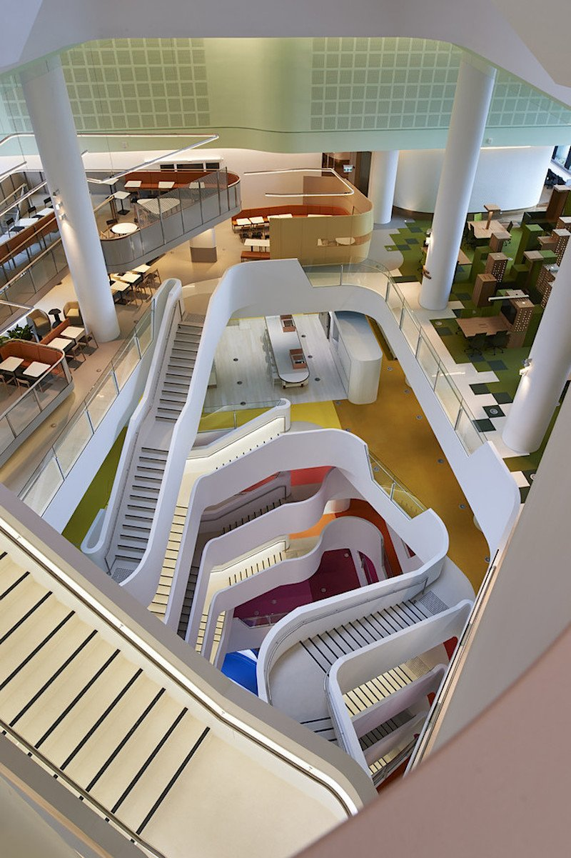 when-designing-the-structure-hassell-focused-on-bright-colors-curved-stairways-and-creating-a-positive-work-environment.jpg