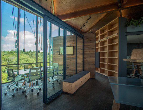 Wooden partitions and glass panels help divide the space without making it feel closed in or closing the spaces off.