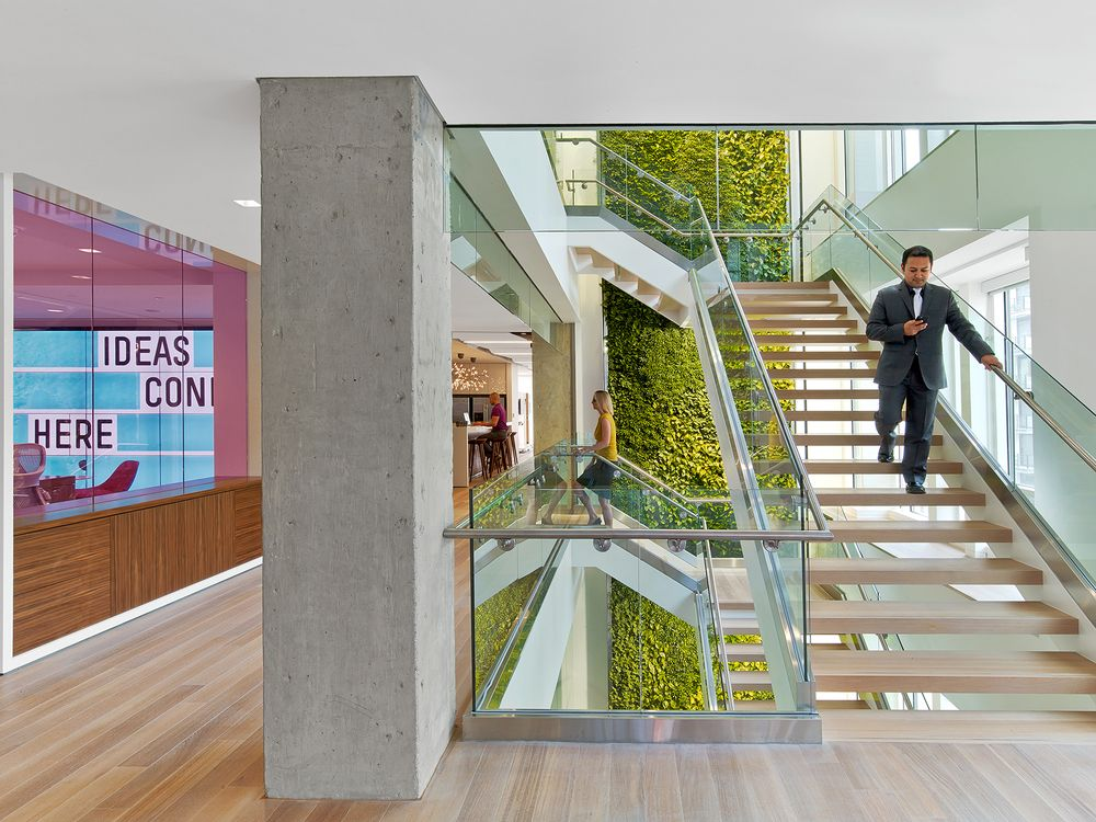 Nixon Peabody green wall and stairs, designed by Perkins+Will Image courtesy of Nixon Peabody/Eric Laignel