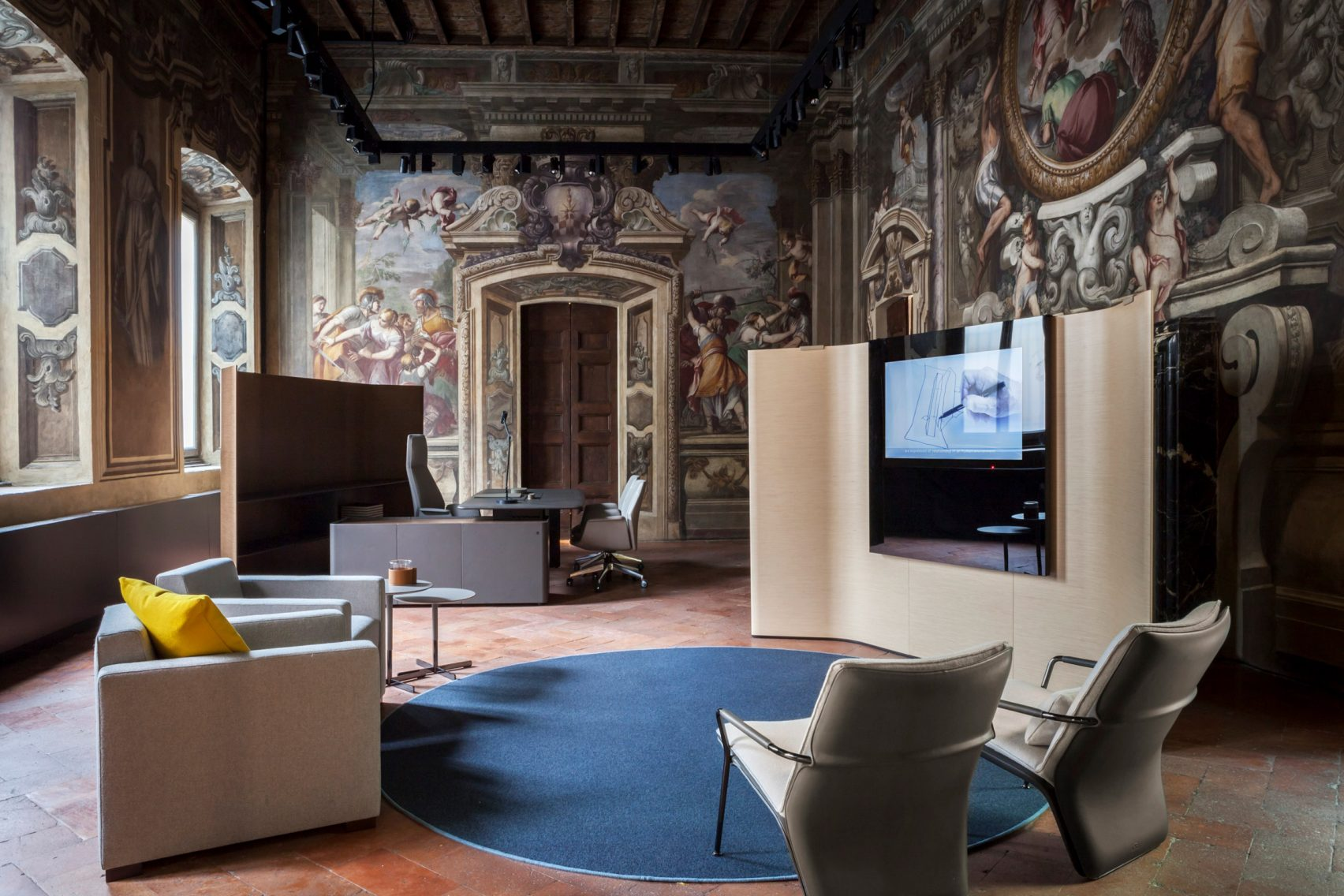 Poltrona Frau's flagship store is housed within an old Milanese building