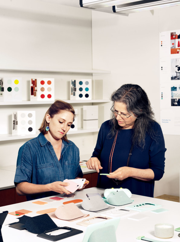 Hardware design chief  Ivy Ross  (right) and designer  Leslie Greene  compare colors across Google product lines, from Nest stands to Pixel phones, in the lab's Color room. [Photo:  Cody Pickens ]