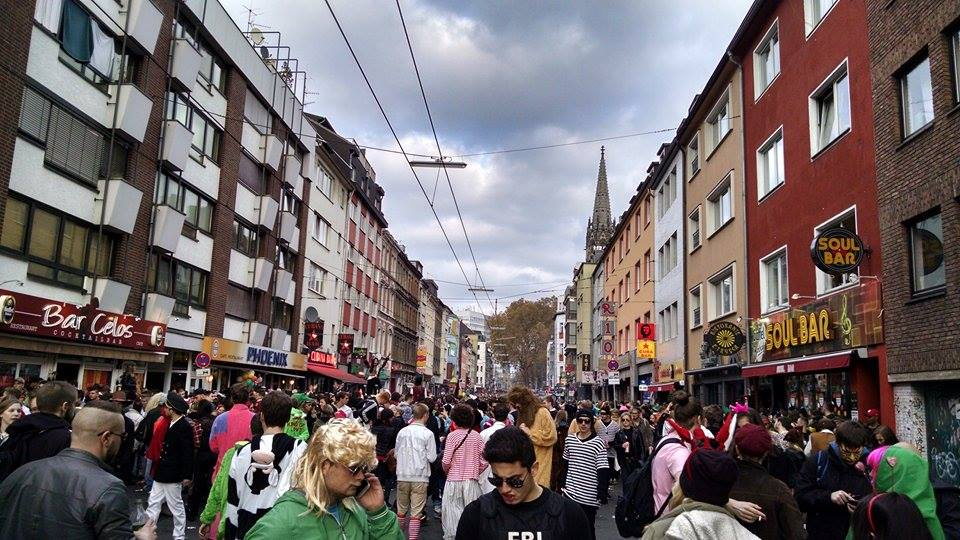 The crowd on Zuelpicherstrasse bringing in Karneval. Here, you can see a cow, an FBI agent, and a guy wearing a blond mullet. Note the electric lines overhead; this party is happening right on the tracks!