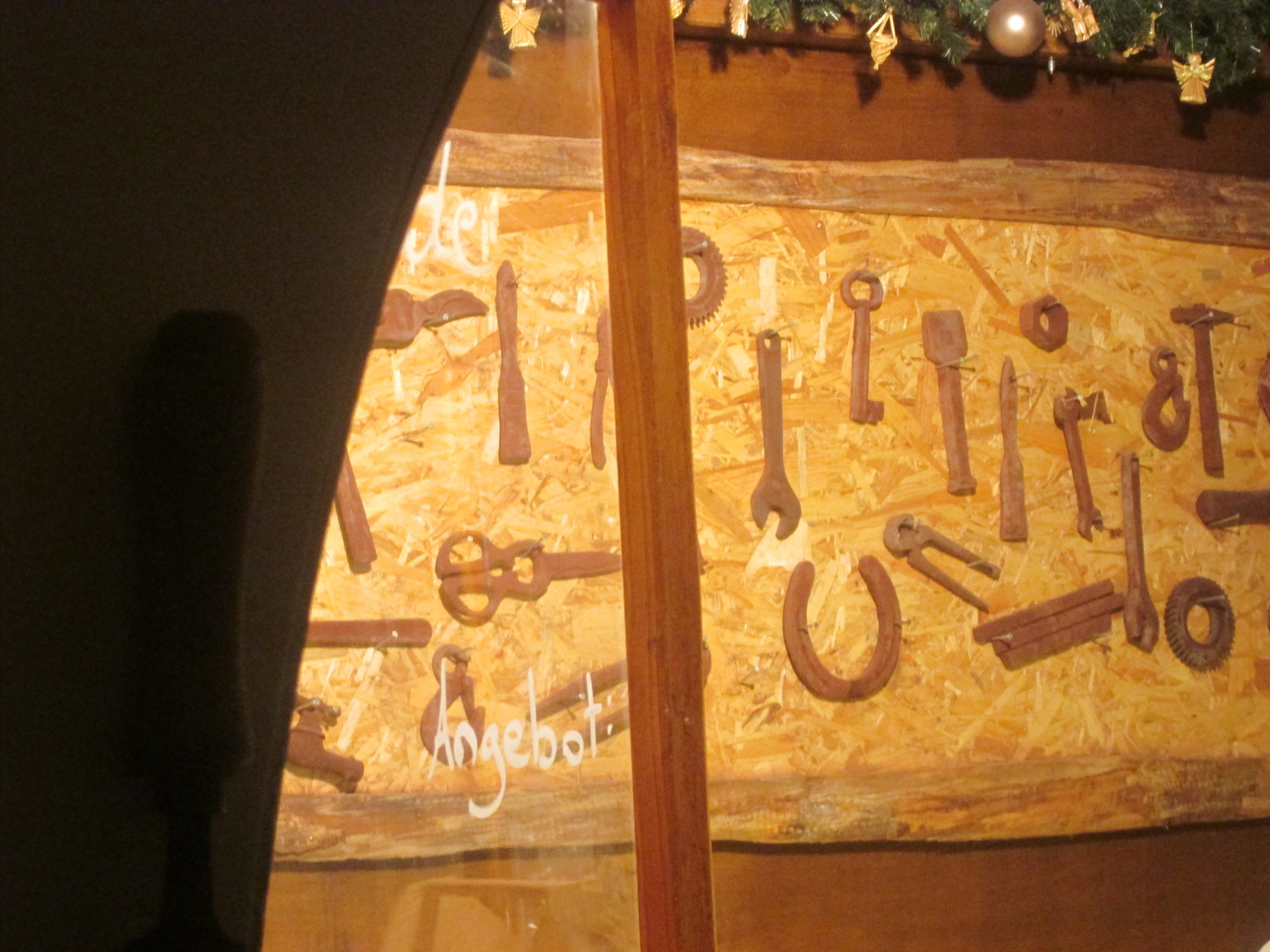 Chocolates in the shape of various hardware on display at a stand in the Neumarkt Weihnachtsmarkt