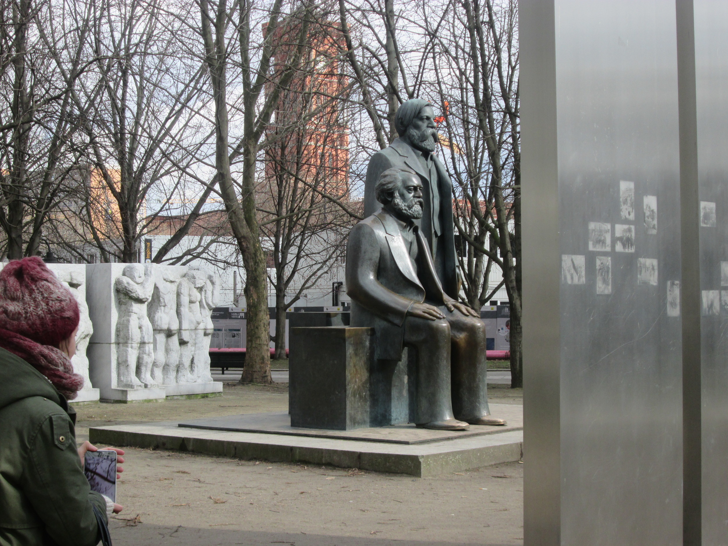 Statues of Karl Marx (seated) and Friedrich Engels (standing) in the Marx-Engels-Forum in former East Berlin