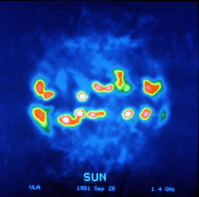 Radio image of the Sun recorded by the VLA in 1981. The brightest regions are part of the corona but beyond sunspots. (NRAO/AUI, retrieved from  PrimaLuceLab )
