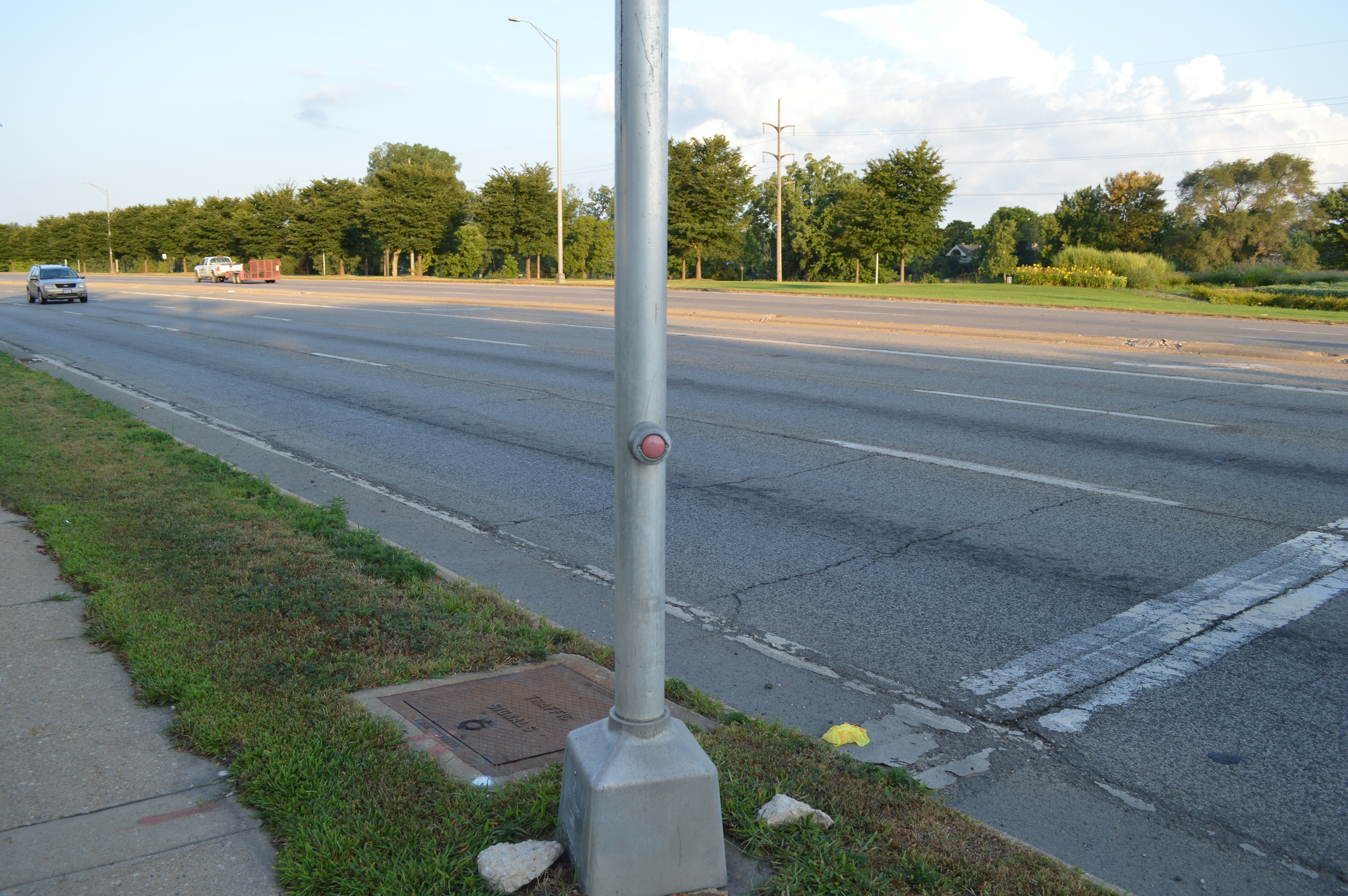 Southeast corner of Ethel Ave. and 251 intersection, an unassuming crosswalk button capable of stopping 6 lanes of commuter traffic.