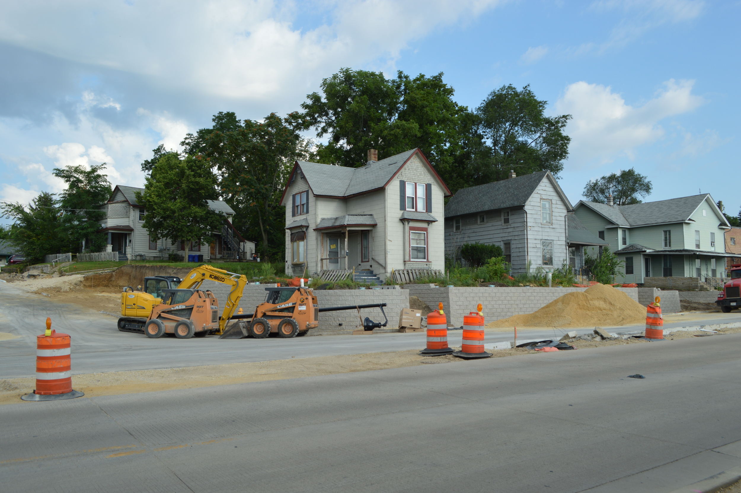 South Main and Lincoln, photo taken Saturday (August 15, 2015). Yard is nonexistent, retaining wall doubled, trees gone, driveway gone (same story for many houses in this stretch of road). Sign on door indicates that house is condemned.