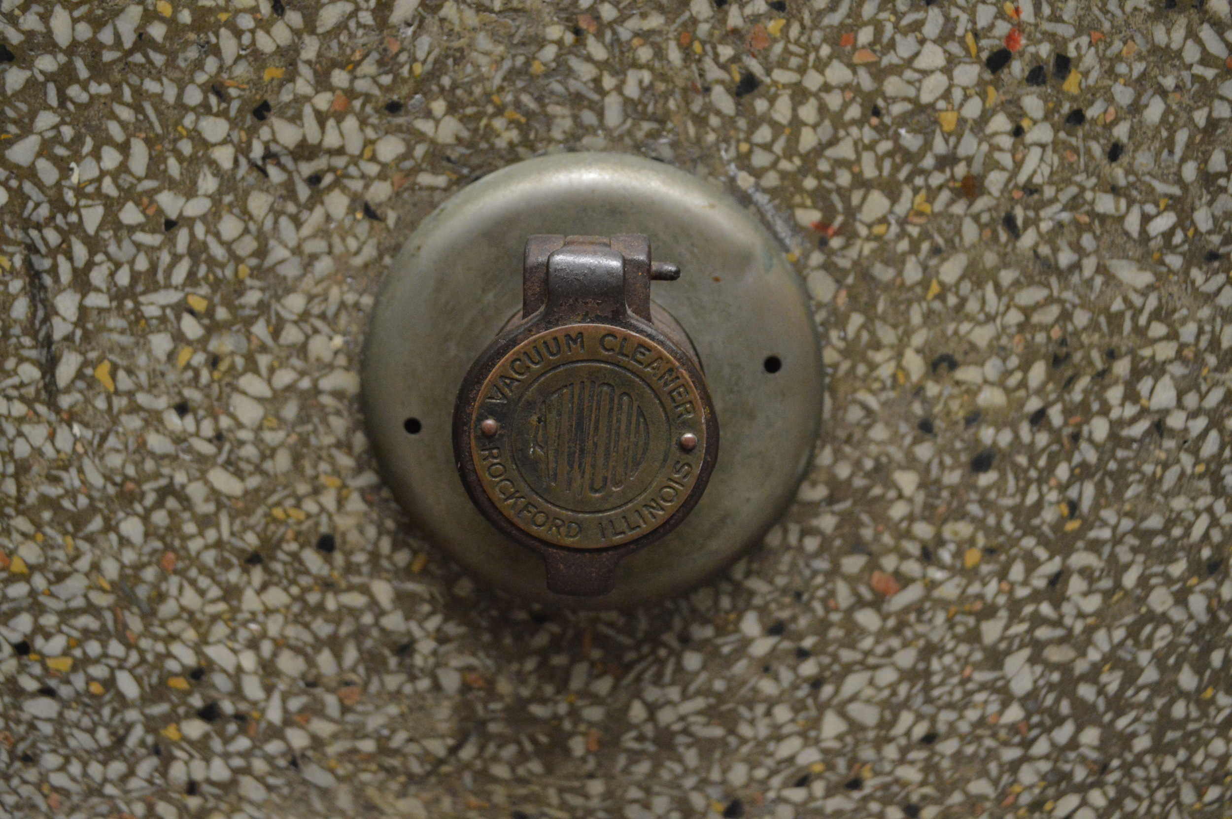 Original central vacuum hook-up, manufactured in Rockford, Illinois, installed at Walker Elementary School.